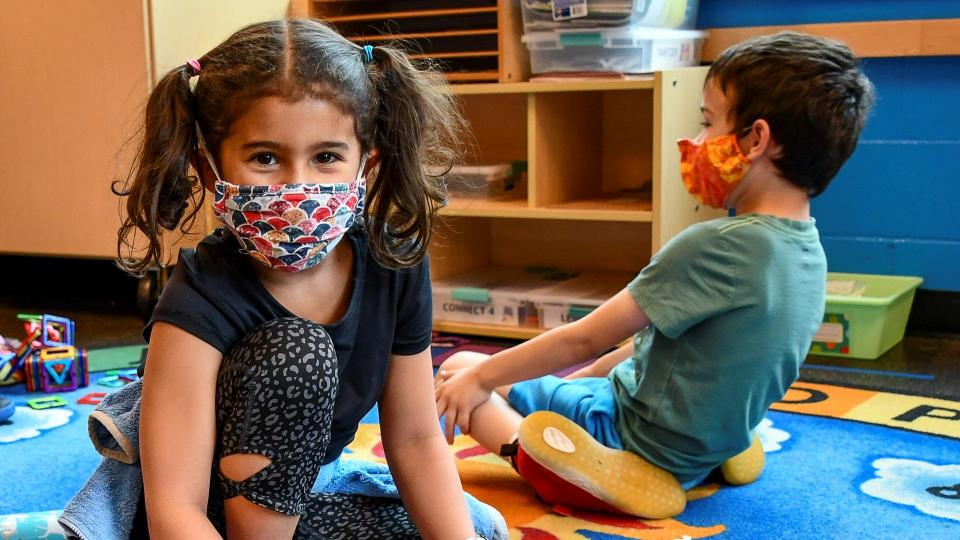 Two students in a community hub wearing masks