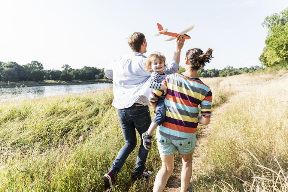 Family running in a field.