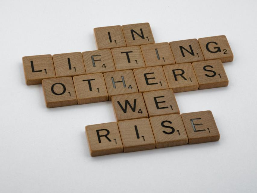 In Lifting Others We Rise