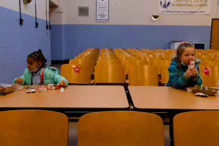 Two students eating breakfast in the cafeteria